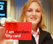 Woman holding up Amsterdam City Card